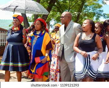 Traditional South African Wedding Between, Xhosa and Ndebele - Johannesburg, South Africa, 29 October 2017. Bride being followed by uncle and singers