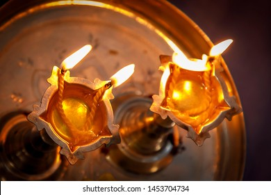 Traditional south indian brass oil lamp 'Nilavilakku /Deepam '. During events like housewarming, marriage etc., the Nilavilakku is lighted before starting the rituals - Image