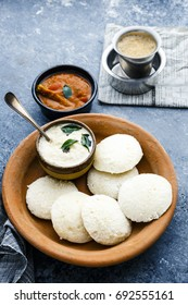 A traditional south Indian breakfast of fresh steamed Indian Idly (Idli / rice cake) served with coconut chutney ,sambar and filter coffee