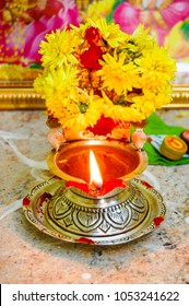Traditional south indian Kamatchi lamp with beautiful flowers