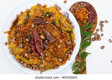Traditional South Indian pumpkin curry / dish Kerala, India. seasoned, coconut oil, Indian spices for cooking. Lentils, side dish for rice/ coconut rice in traditional Onam sadhya, Vishu, Pongal