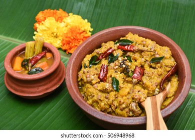 Traditional South Indian pumpkin curry / dish in clay pot Kerala, India. seasoned, coconut oil, Indian `spices for cooking. Lentils, for rice/ coconut rice in traditional Onam sadhya, Vishu, Pongal