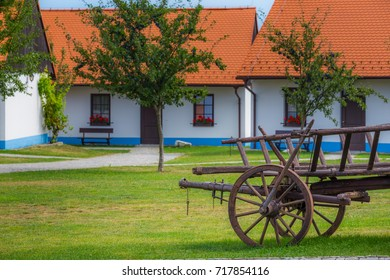 Traditional south Moravian architecture. Czech village with traditional houses and wooden wagon,