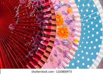 Traditional souvenir: colorful Spanish flamenco hand fans. Downtown Nerja, Spain.
