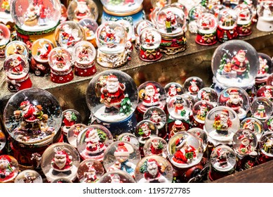 Traditional Souvenirs snow globes and toys Santa Claus Dolls At European Winter Christmas Market Souvenir