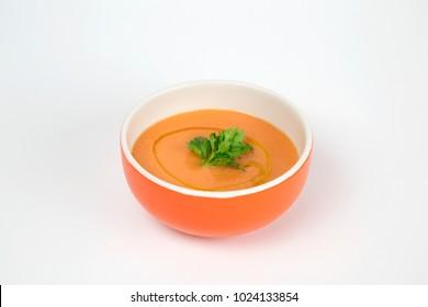 Traditional spanish andalusian tomato cream soup - salmorejo. Andalusian gazpacho in orange porcelain bowl