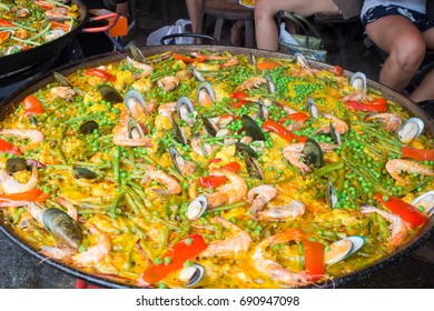 Traditional spanish cuisine - seafood paella with shrimps, mussels, fish, rice, lemon and herbs