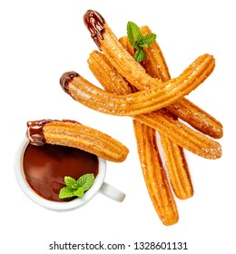Traditional Spanish dessert Churros with sugar and hot  chocolate sauce, top view