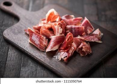 Traditional Spanish Jamon Serrano ham, Prosciutto Crudo, Parma ham, Italian antipasto.