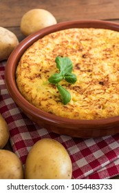 Traditional spanish omelette close up,  view from above. Spanish tortilla on a rustic wooden texture with a place for text