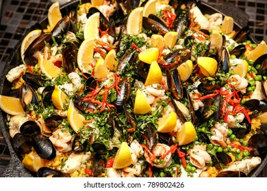 Traditional Spanish paella with seafood and chicken. Top view.