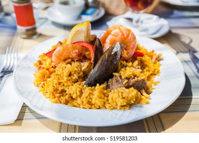 traditional spanish paella with seafood and meat