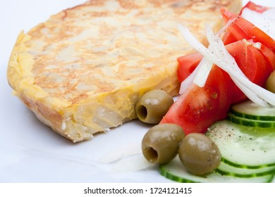 traditional spanish potato omelette with salad