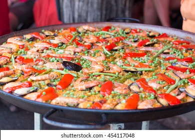 Traditional spanish rice paella with sea food. Mixed seafood stir fried spicy and salad. Spicy seafood.Traditional seafood paella