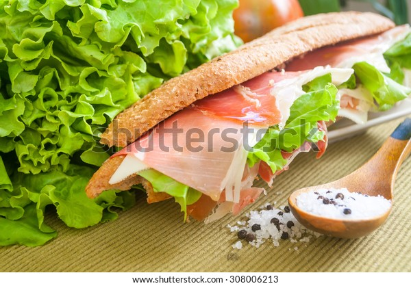 traditional Spanish sandwich with ham and cheese, delicious, fresh, diet, with lettuce bocadillo con jamon y queso