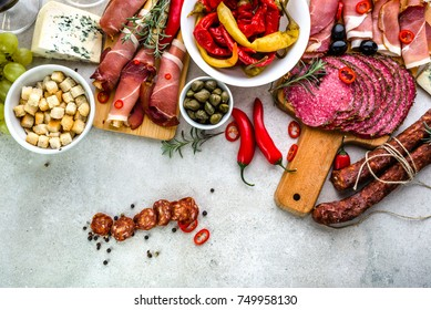 Traditional spanish tapas on table, food from spain, variety dishes, cold meat chorizo, ham and salami