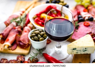 Traditional spanish tapas, wine snack set, food from spain, cheese, meat, vegetables and other appetizers on table