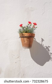 Traditional Spanish wall mounted flower pot.