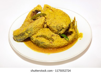 Traditional spicy Indian fish cuisine prepared with tasty Hilsa fish in mustard gravy with green chili.