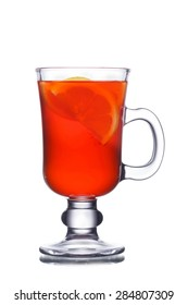 Traditional  spicy toddy  garnished with lemon slice and cinnamon stick. Christmas hot beverage