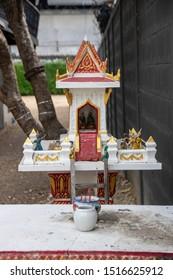 traditional spirit house outside a house in Kanchanaburi, Thailand