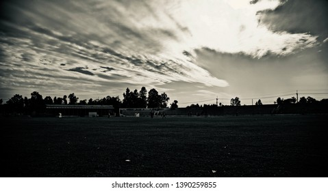 A traditional sports ground with dark cloudy sky unique photo