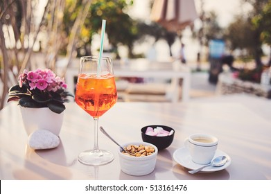 Traditional Spritz aperitif  and nuts in a bar in Italy. Sunny day.