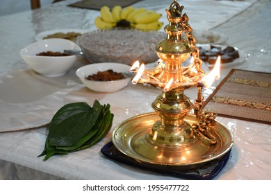 Traditional Sri Lankan Avurudu Table  oil lamp in 2021. Sinhalese and Hindu people in Sri Lanka celebrate Avurudu Festival in April every year with homemade sweets.