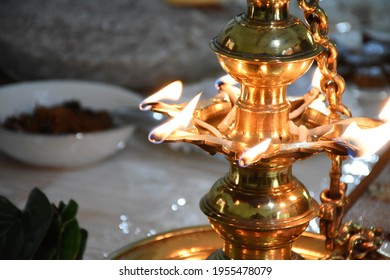 Traditional Sri Lankan Avurudu Table with oil lamp in 2021. Sinhalese and Hindu people in Sri Lanka celebrate Avurudu Festival in April every year with homemade sweets.