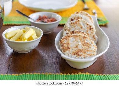 Traditional sri lankan coconut pol roti flat bread with butter and lunu miris dip from red onion and chilli