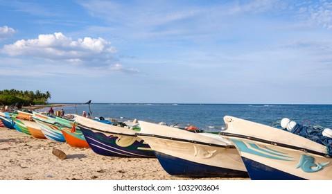 Traditional Sri Lankan fishing boats laying on the pasikuda beach in Kalkuda on the east coast of Sri Lanka. Pasikuda, Sri Lanka.