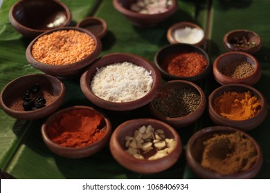 Traditional Sri Lankan Herbs, Spices and Ingredients in clay pots on a banana leaf