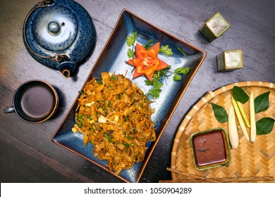 Traditional Sri Lankan kottu roti in wooden background