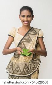 Traditional Sri Lankan welcome by a Sri Lankan girl