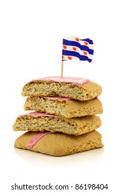 """traditional stacked Dutch and Frisian pink glazed pastry called """"fondant koek"""" with a frisian flag toothpick on a white background"""