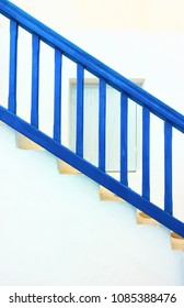 Traditional staircase with blue railing in Myconos Island, Greeece