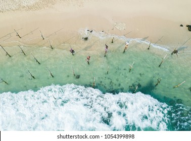 Traditional stilt fishermen in Sri Lanka. Aerial view, drone photo