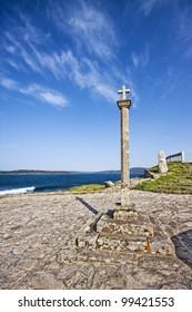 Traditional stone cross erected along the coast of Galicia in Muxia, La Coruna, Spain