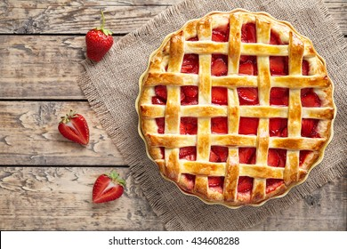 Traditional strawberry pie tart cake sweet baked pastry food on rustic wooden table background