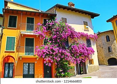 Traditional street and beautiful houses facades in Gardone Riviera at Garda Lake,Northern Italy