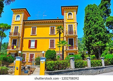 Traditional street and yellow houses Gardone Riviera Italy
