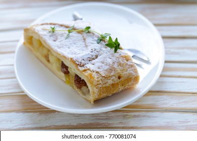 traditional strudel from puff pastry with apples