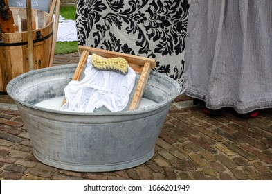 Traditional style washing tub with wash board and brush