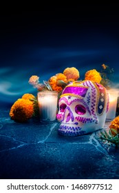 """Traditional sugar skull used at mexican offerings or """"ofrendas"""" for Day of the Dead celebration with marigold or """"cempasuchil"""" flowers. high contrast image"""