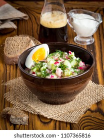 Traditional summer Russian cold soup with kvass, okroshka with ham and vegetables, food