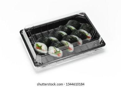 Traditional Sushi roll with crab meat stick, nori and vegetables in a plastic container for take away