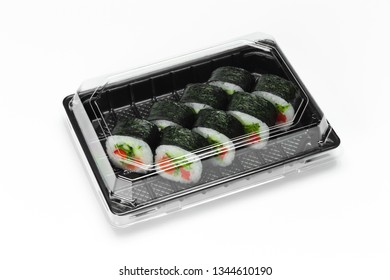 Traditional Sushi roll with salmon, nori and vegetables in a plastic container for take away