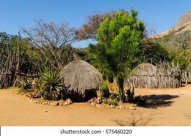 Traditional Swazi Beehive huts and fences in Mantenga Swazi Cultural Village, Swaziland.