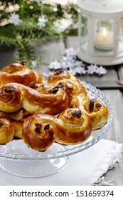 Traditional swedish buns in christmas setting. A saffron bun, in Swedish lussebulle or lussekatt.