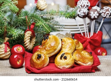 traditional swedish buns in christmas setting a saffron bun in swedish lussebulle or lussekatt - Traditional Swedish Christmas Decorations